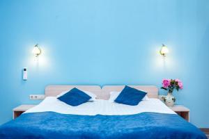 Кровать или кровати в номере Leto Apartments