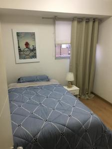 A bed or beds in a room at Andean Appartement