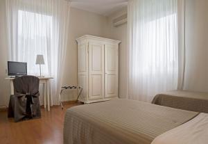 Letto o letti in una camera di Hotel Positano