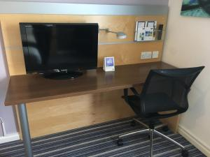 A television and/or entertainment center at Holiday Inn Express Birmingham - Castle Bromwich