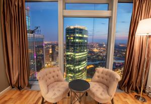 Гостиная зона в MosAPTS apartments Moscow City 61