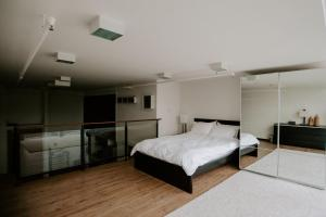 A bed or beds in a room at Cayden Riverfront Residences