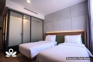 A bed or beds in a room at Ceria Hotel