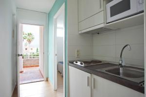 Küche/Küchenzeile in der Unterkunft Club Sa Coma