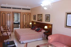 A bed or beds in a room at Villa VIK - Hotel Boutique