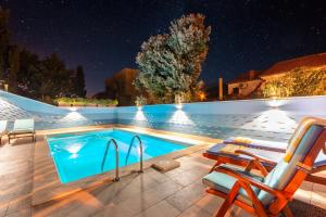 The swimming pool at or near Apartment Villa Camellia - Adults Only