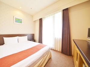 Tempat tidur dalam kamar di Hotel WBF Grande Hakodate