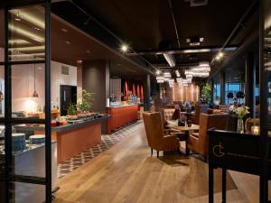 En restaurant eller et andet spisested på Radisson Blu Caledonien Hotel, Kristiansand