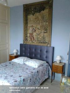 A bed or beds in a room at Chambres d'hôtes Intra Muros