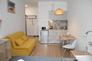 A kitchen or kitchenette at ENJOY! Apartments & Studios