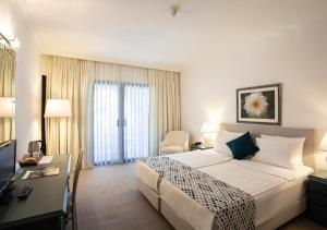 A bed or beds in a room at Hotel Karia Princess