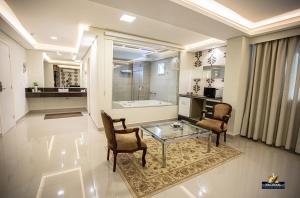 Uma área de estar em Nacional Palace Hotel