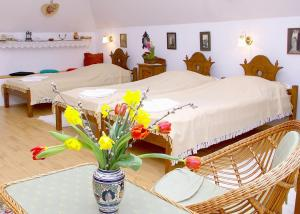 A bed or beds in a room at Nádas Fogadó