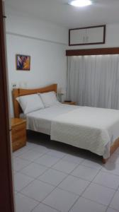 A bed or beds in a room at Ondina Apart Hotel Salvador