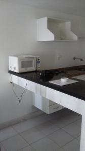A kitchen or kitchenette at Ondina Apart Hotel Salvador