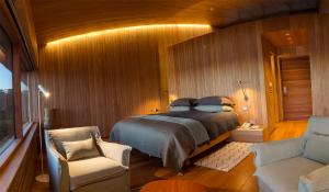 A bed or beds in a room at Tierra Chiloe