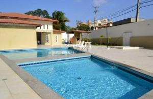 The swimming pool at or close to Nosso Aconchego