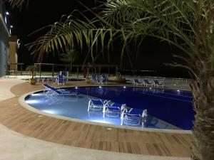 The swimming pool at or close to Golden Lake Arraial RJ