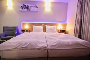 A bed or beds in a room at Hotel Val de l'Our
