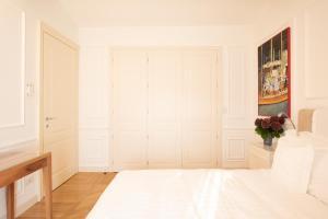Ein Bett oder Betten in einem Zimmer der Unterkunft Borgolago Suites