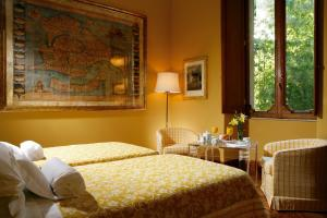 A bed or beds in a room at Villa Spalletti Trivelli - Small Luxury Hotels of the World