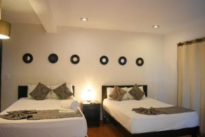 Cama o camas de una habitación en Isla Caracol