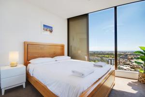 A bed or beds in a room at Swainson at Vue