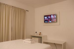 A television and/or entertainment center at Hotel São Marcos