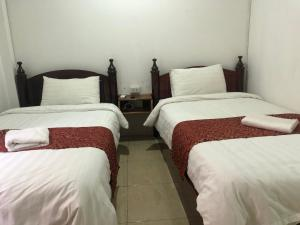 A bed or beds in a room at Little Freedom Friendlys Place