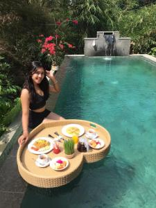 The swimming pool at or close to Gek House Ubud Bali