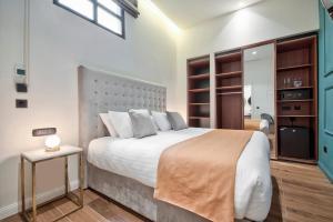 Łóżko lub łóżka w pokoju w obiekcie 23 Boutique Hotel