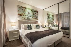 A bed or beds in a room at Quest Frankston on the Bay