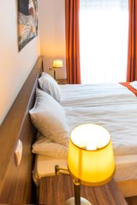 A bed or beds in a room at AirPark Balice