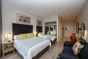 A bed or beds in a room at The James Suites