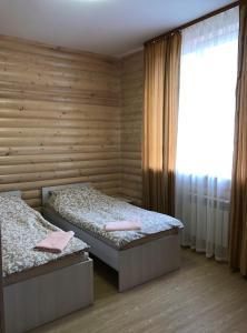 Кровать или кровати в номере Коттедж на горнолыжной 37а