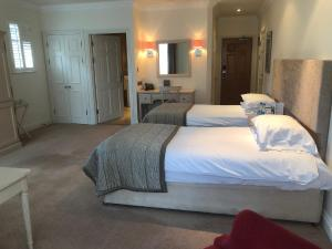 A bed or beds in a room at Foxhills