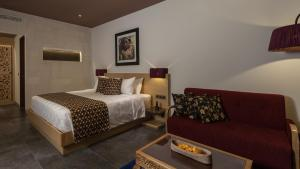 A bed or beds in a room at Kejora Suites