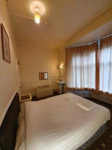 A bed or beds in a room at The Handforth Lodge