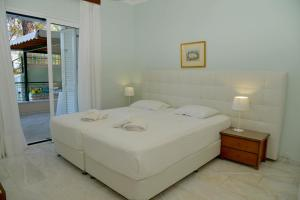 A bed or beds in a room at Saint Nicholas Beach Apartments