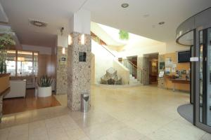 The lobby or reception area at Hotel Lovec