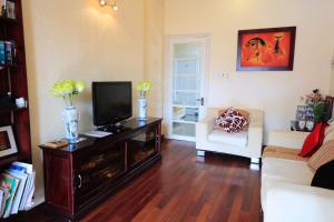 A television and/or entertainment centre at The HillSide Homestay Hue