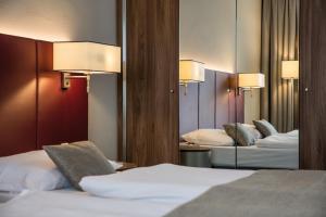 Ein Bett oder Betten in einem Zimmer der Unterkunft Austria Trend Hotel Europa Salzburg