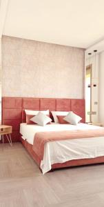 A bed or beds in a room at Dar Rekik Argan golf resort Villa