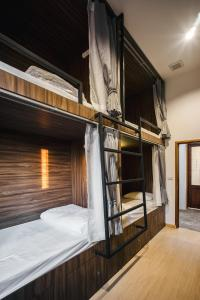 A bunk bed or bunk beds in a room at Hostel Urby