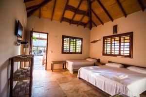 Cama ou camas em um quarto em Pousada Vento do Kite