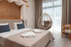 Кровать или кровати в номере Side Royal Style Hotel