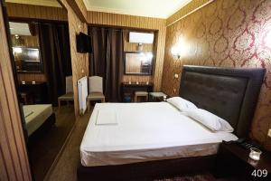 Ένα ή περισσότερα κρεβάτια σε δωμάτιο στο Ξενοδοχείο Atlantic