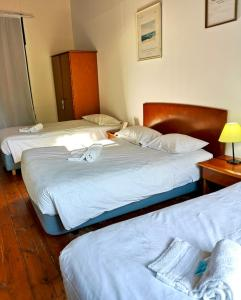 A bed or beds in a room at Algarve Hostel