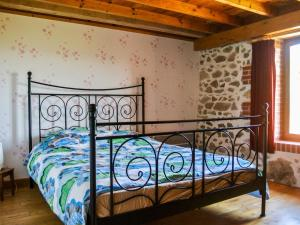A bed or beds in a room at Lovely Holiday Home with Pool in Lavoine