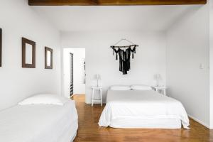 A bed or beds in a room at A PERFECT STAY - Ourmuli Cabin